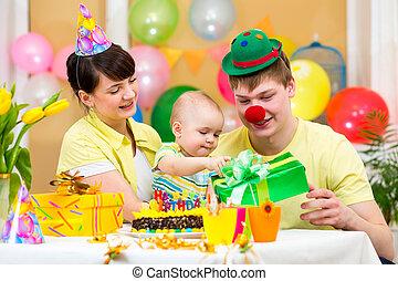 family celebrating first birthday of baby