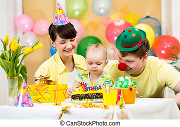 family celebrating first birthday of baby girl