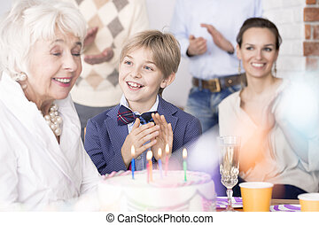 Family celebrating grandma's birthday