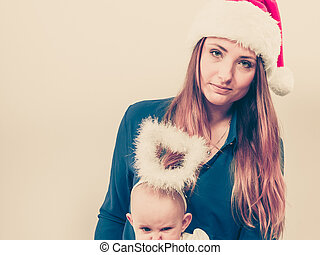 42c3c29ed3c Family celebration concept. christmas woman with cute baby ...