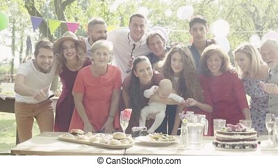 Family celebration or a garden party outside in the...