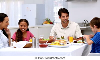 Family chatting and having dinner