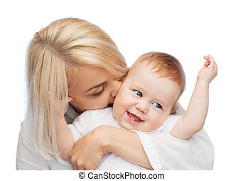 happy mother kissing smiling baby