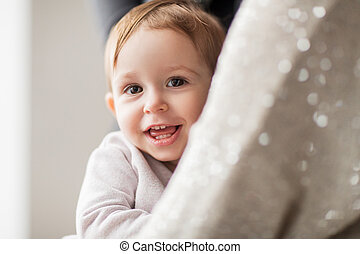happy smiling little baby girl with mother
