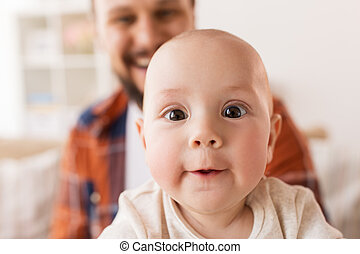 close up of happy little baby boy with father