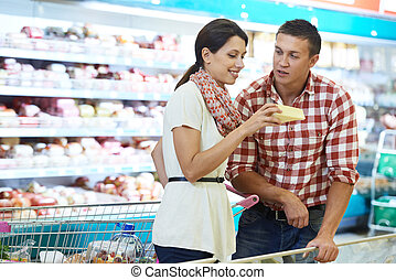Family choosing food at shopping in supermarket