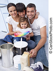 Family chosing colours to paint new house - Happy family...
