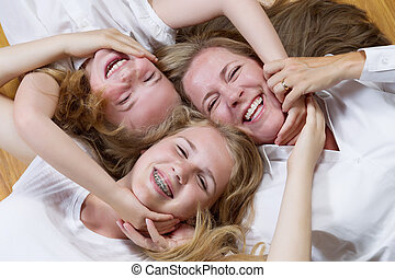 Family Circle of Mother and her girls on the floor
