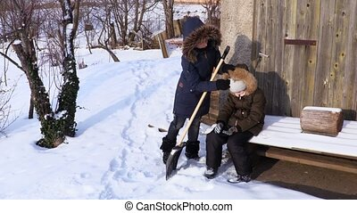 Family clean up yard in cold winter day