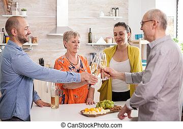 Family clinking wine glasses