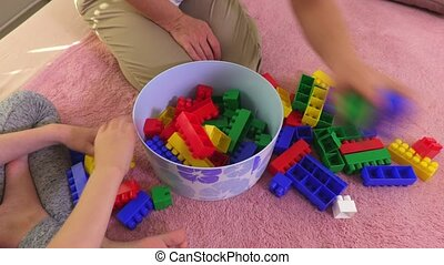 Family collects colorful toy bricks