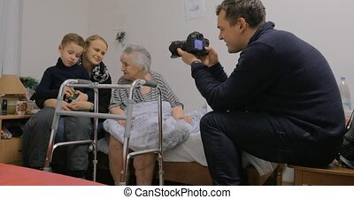 Family coming to visit elderly grandma in the hospital