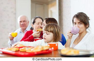 family communicate around tea table