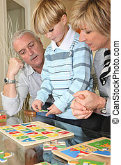 Family completing a puzzle together