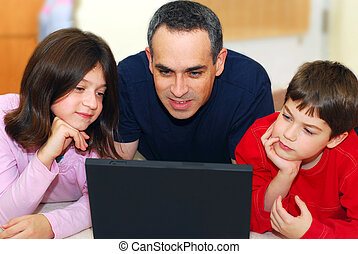 Family computer - Portrait of a father with two children ...