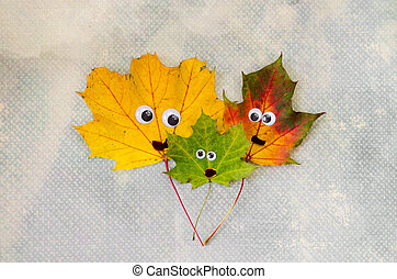 family concept with autumn leaves