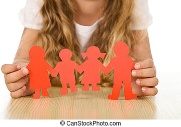 Family concept with little girl holding paper people
