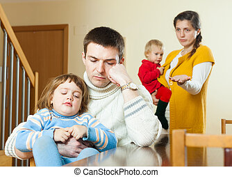 Family conflict. Sad man listening to woman at home