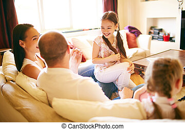 Family conversation - A young friendly family of four...