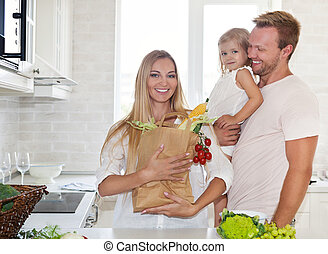 Family cooking in a modern kitchen setting