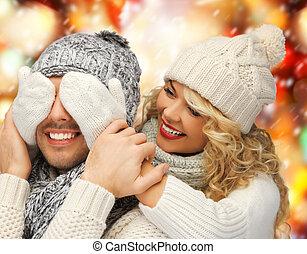 family couple in a winter clothes - christmas, x-mas,...