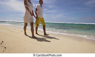 Family couple on the beach.