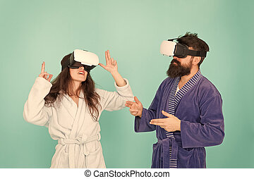 family couple wear vr glasses. girl and man hipster relax in bathrobe. morning start with future technology. Another reality is here. innovation in family. create your reality. world of immagination