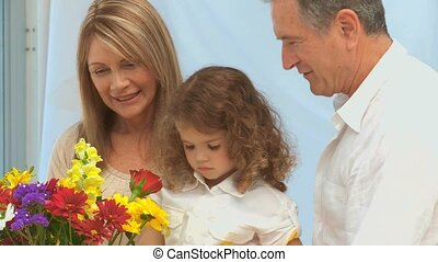 Family creating a bunch of flowers