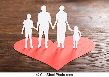 Family Cut-out On Red Shape Heart - Close-up Of A Family...