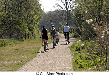Family cycling - family cycling on a summers day along a...