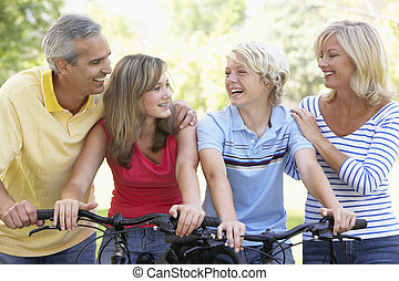Family Cycling Through A Park