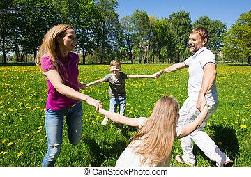 Family dancing in park