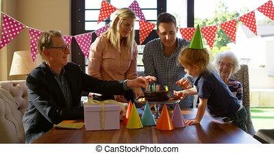 Family decorating birthday cake in living room 4k - Family ...