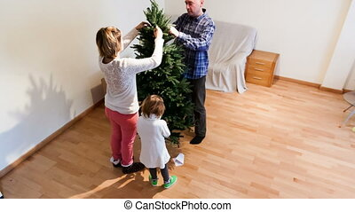 family   decorating Christmas tree