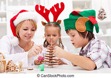 Family decorating the gingerbread christmas tree