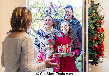 Family delivering presents at Christmas - Family delivering...