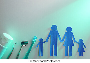 Family dental health concept with tools on table green light