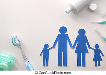 Family dental hygiene with tools on white table top