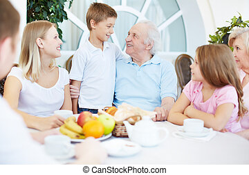 Family dinner - Portrait of senior and young couples with...