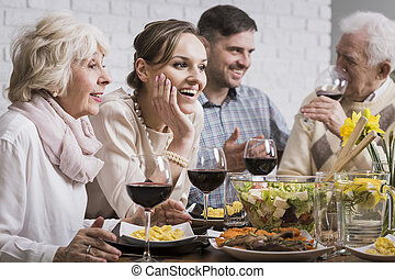 Family dinner with wine - Family dinner of a young couple ...
