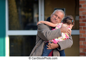 Grandfather embrace his granddaughter after family disaster.