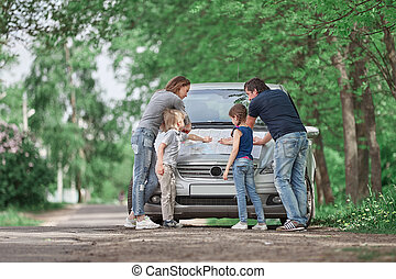 family discusses the road map on a family trip