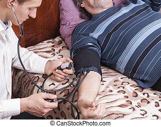 doctor measures the blood pressure