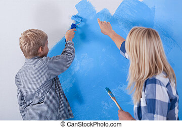 Family during wall painting