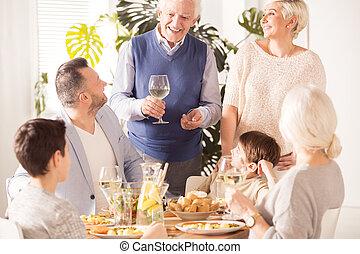 Family eating anniversary dinner