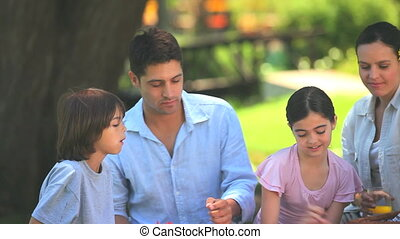 Family eating fruits outdoors