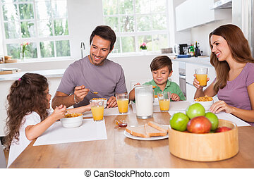 Family eating healthy breakfast in kitchen