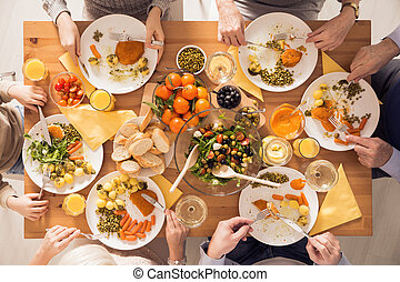 Family eating healthy meal - Top view of family eating...
