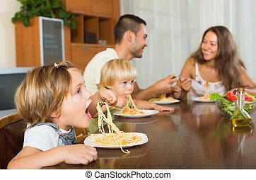 Family eating spaghetti
