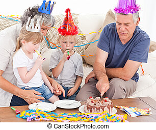 Family eating the birthday cake together